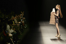 A model displays a creation by Japanese designer Motonari One during the 2013 spring/summer collection at Tokyo Fashion Week in Tokyo,Thursday, Oct. 18, 2012.  (AP Photo/Koji Sasahara)
