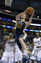 Utah Jazz forward Gordon Hayward (20) shoots against Los Angeles Clippers guard Willie Green (34) and center DeAndre Jordan (6) during the first half of their preseason NBA basketball game, Wednesday, Oct. 17, 2012, in Los Angeles.  (AP Photo/Mark J. Terrill)