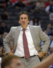 Los Angeles Clippers head coach Vinny Del Negro yells to team during the first half of their preseason NBA basketball game against the Utah Jazz, Wednesday, Oct.17, 2012, in Los Angeles. The Clippers won 96-94.  (AP Photo/Mark J. Terrill)