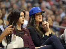 Kendall Jenner and Khloe Kardashian watch the Los Angeles Clippers play the Utah Jazz during their preseason NBA basketball game, Wednesday, Oct.17, 2012, in Los Angeles. The Clippers won 96-94.  (AP Photo/Mark J. Terrill)