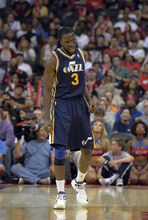 Utah Jazz forward DeMarre Carroll reacts during the second half of their preseason NBA basketball game against the Los Angeles Clippers, Wednesday, Oct.17, 2012, in Los Angeles. The Clippers won 96-94.  (AP Photo/Mark J. Terrill)