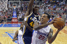 Los Angeles Clippers forward Matt Barnes, right, shoots against Utah Jazz forward Jeremy Evans during the first half of their preseason NBA basketball game, Wednesday, Oct.17, 2012, in Los Angeles.  (AP Photo/Mark J. Terrill)