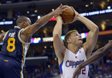 Los Angeles Clippers forward Blake Griffin, right, shoots against Utah Jazz guard Randy Foye during the first half of their preseason NBA basketball game, Wednesday, Oct. 17, 2012, in Los Angeles.  (AP Photo/Mark J. Terrill)