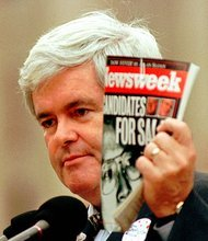 FILE - In this Thursday, Oct. 24, 1996 file photo, House Speaker Newt Gingrich, R-Ga., holds a copy of Newsweek Magazine and makes comments about President Clinton and the Democratic party in Jackson, Miss. Newsweek announced Thursday, Oct. 18, 2012 that it will end its print publication after 80 years and shift to an all-digital format in early 2013. Its last U.S. print edition will be its Dec. 31 issue. The paper version of Newsweek is the latest casualty of a changing world where readers get more of their information from websites, tablets and smartphones. It's also an environment in which advertisers are looking for less expensive alternatives online (AP Photo/Dan Loh, File)