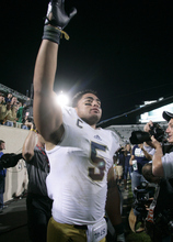 Notre Dame's Manti Te'o acknowledges fans following a 20-3 win over Michigan State in an NCAA college football game, Saturday, Sept. 15, 2012, in East Lansing, Mich. (AP Photo/Al Goldis)