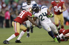 Seattle Seahawks running back Marshawn Lynch (24) runs against San Francisco 49ers running back Anthony Dixon (24) during the second quarter of an NFL football game in San Francisco, Thursday, Oct. 18, 2012. (AP Photo/Marcio Jose Sanchez)