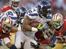 Seattle Seahawks running back Marshawn Lynch (24) runs against the San Francisco 49ers during the second quarter of an NFL football game in San Francisco, Thursday, Oct. 18, 2012. (AP Photo/Marcio Jose Sanchez)