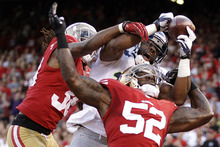 San Francisco 49ers linebacker Patrick Willis (52) and safety Dashon Goldson break up a pass intended for Seattle Seahawks wide receiver Braylon Edwards during the second quarter of an NFL football game in San Francisco, Thursday, Oct. 18, 2012. (AP Photo/Ben Margot)