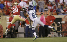 San Francisco 49ers cornerback Chris Culliver (29) breaks up a pass intended for Seattle Seahawks wide receiver Golden Tate (81) during the second quarter of an NFL football game in San Francisco, Thursday, Oct. 18, 2012. (AP Photo/Marcio Jose Sanchez)