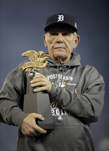 Detroit Tigers manager Jim Leyland holds the William Harridge Trophy after his team won the American League championship series against the New York Yankees at Game 4, Thursday, Oct. 18, 2012, in Detroit. The Tigers, who won 8-1, move on to the World Series.  (AP Photo/Matt Slocum)
