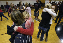 Scott Sommerdorf  |  The Salt Lake Tribune              Aimee Bates, a sophomore at Lone Peak High School, hugs a classmate as the group breaks up after a full day in the small gym taking part in the