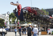 The burned remains of Big Tex are lowered from his display at the State Fair of Texas  Friday, Oct. 19, 2012, in Dallas.  Big Tex, the metal cowboy whose slow drawl of