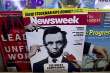 A copy of Newsweek is seen at Joe's Smoke, Thursday, Oct. 18, 2012, in Portland, Maine. Newsweek announced Thursday, Oct. 18, 2012 that it will end its print publication after 80 years and shift to an all-digital format in early 2013. Its last U.S. print edition will be its Dec. 31 issue. The paper version of Newsweek is the latest casualty of a changing world where readers get more of their information from websites, tablets and smartphones. (AP Photo/Robert F. Bukaty)