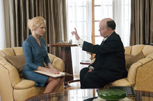 This image released by HBO shows Toby Jones, portraying Alfred Hitchcock, right, with Sienna Miller, portraying Tippi Hedren, in a scene from the film
