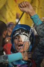 An Egyptian protester wearing a headband with Arabic writing that reads,