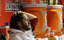 St. Louis Cardinals starting pitcher Lance Lynn reacts in the dugout after being taken out of the game in the fourth inning of Game 5 of baseball's National League championship series against the San Francisco Giants, Friday, Oct. 19, 2012, in St. Louis. (AP Photo/David J. Phillip)