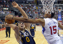 Utah Jazz center Enes Kanter, left, is blocked by Los Angeles Clippers center Ryan Hollins during the second half of their preseason NBA basketball game, Wednesday, Oct. 17, 2012, in Los Angeles. The Clippers won 96-94.  (AP Photo/Mark J. Terrill)