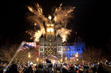 Tribune file photo Thousands of fans reveled while fireworks exploded above the City and County Building in 2002 to welcome the Olympic torch relay to Salt Lake City, while giant portraits of athletes graced the sides of downtown buildings and helped create a festive atmosphere.