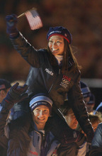 Kyoko Ina and John Zimmerman, USA pairs figure skaters, enter the stadium during Closing Ceremonies. Leah Hogsten/photo