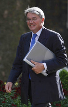 FILE This Thursday, May 13, 2010 file photo shows Andrew Mitchell, Britain' newly appointed Minister for International Development, and chief whip arriving at British Prime Minister David Cameron official residence at 10 Downing Street in central London, for the first cabinet meeting. The British government's chief whip says Friday Oct. 19, 2012 he has resigned following a class-tainted row over a confrontation with police officers in which he was accused of a foul-mouthed tirade. Mitchell, a cyclist, was accused by police of confronting them angrily after they asked him to get off his bicycle to pass through gates.  Police insisted Mitchell had used the word