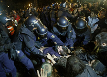 File - In this Sept. 26, 2012 file photo, police clash with protestors during a demonstration at the parliament against austerity measures announced by the Spanish government in Madrid. Spain's government said Friday Oct. 19, 2012 it is considering a ban on photographing, filming and reproducing images of police and state security forces while