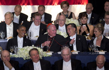 From left, President Barack Obama, Cardinal Timothy Dolan, Republican presidential candidate, former Massachusetts Gov. Mitt Romney, and his wife Ann Romney attend the Archdiocese of New York's 67th Annual Alfred. E. Smith Memorial Foundation Dinner, Thursday, Oct. 18, 2012, at the Waldorf Astoria Hotel in New York. (AP Photo/Carolyn Kaster)