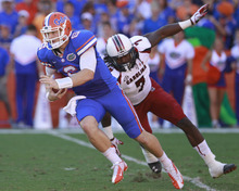 Florida quarterback Jeff Driskel (6) scrambles as he is chased by South Carolina defensive end Jadeveon Clowney (7) during the first half of an NCAA college football game, Saturday, Oct. 20, 2012, in Gainesville, Fla. Florida won the game 44-11.(AP Photo/John Raoux)