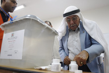 A Palestinian dips his finger in ink at a polling station in the West Bank city of Ramallah, Saturday, Oct. 20, 2012. Palestinians voted for mayors and local councils in 93 communities across the West Bank on Saturday, their first chance to cast ballots in six years. (AP Photo/Majdi Mohammed)