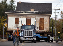 Lennie Mahler  |  The Salt Lake Tribune A truck pulls the Casto Home, weighing about 110-tons, along Murray Holladay Road to be set in the City Hall Park about a half mile away. Saturday, Oct. 20, 2012.