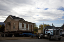 Lennie Mahler  |  The Salt Lake Tribune A truck pulls the Casto Home, weighing about 110-tons, out of its old location on Murray Holladay Road to be set in the City Hall Park about a half mile away. Saturday, Oct. 20, 2012.
