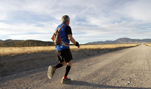 Al Hartmann  |  The Salt Lake Tribune Competetive-elite runner Barry Hopkins hits the wide open valley at mile 7 during the Pony Express Trail 100 Endurance Run Friday, Oct. 19. Some 75 entrants and their support teams will run the 50-mile course or the 100-mile course along the historic Pony Express route in the west desert areas of Tooele and Juab counties.