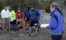 Al Hartmann  |  The Salt Lake Tribune Race organizer Davy Crockett, right, gives last-minute instructions to the 15 runners in the competive-elite class at the start of the Pony Express Trail 100 Endurance Run Friday morning, Oct. 19.    Some 75 entrants and their support teams will run the 50-mile course or the 100-mile course along the historic Pony Express route in the west desert areas of Tooele and Juab counties.