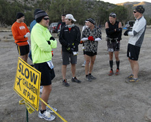 Al Hartmann  |  The Salt Lake Tribune Fifteen runners in the competive-elite class shiver before the start of the Pony Express Trail 100 Endurance Run Friday morning, Oct. 19. Some 75 entrants and their support teams will run the 50-mile course or the 100-mile course along the historic Pony Express route in the west desert areas of Tooele and Juab counties.