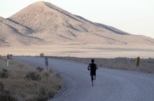 Al Hartmann  |  The Salt Lake Tribune A runner appears of insignificant size to the surrounding mountain and valleys in the Pony Express Trail 100 Endurance Run. Some 75 entrants and their support teams will run the 50-mile course or the 100-mile course along the historic Pony Express route in the west desert areas of Tooele and Juab counties.