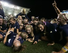 Kim Raff | The Salt Lake Tribune Bonneville players celebrate defeating Bountiful during the 4A girls state championship game at Rio Tinto Stadium in Sandy, Utah on October 19, 2012. Bonneville won the game 1-0.