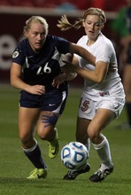 Kim Raff | The Salt Lake Tribune Bountiful player (right) Morgan Cook and Bonneville player Tobin Niebrugge compete for a ball during the 4A girls state championship game at Rio Tinto Stadium in Sandy, Utah on October 19, 2012. Bonneville went on to win the game 1-0.