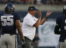 Scott Sommerdorf  |  The Salt Lake Tribune              USU hed coach Gary Anderson cheers his team on during first half play. The Aggies beat Utah 27-20 in OT, Friday, September 7, 2012.