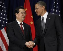 FILE - In this Nov. 12, 2011 file photo, U.S. President Barack Obama, right, meets with Chinese President Hu Jintao at the APEC Summit in Honolulu. In the simplistic narrative of U.S. presidential politics, China is a Hollywood villain, a monetary cheat that is stealing American jobs. But in the debate Tuesday night, Oct. 16, 2012 the one-dimensional caricature offered up by Obama and Republican challenger Mitt Romney obscures the crucial reality of U.S.-China relations: For all the talk about getting tough on Beijing, the U.S. and China are deeply entwined, defying easy solutions to the friction and troubles that beset their relations. (AP Photo/Charles Dharapak, File)