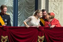 Luxembourg's Prince Guillaume and his father Grand Duke Henri, left, look on as Countess Stephanie and Grand Duchess Maria Teresa kiss on the balcony of the Royal Palace after their wedding in Luxembourg, Saturday, Oct. 20, 2012. (AP Photo/Geert vanden  Wijngaert)