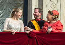 Luxembourg's Prince Guillaume look on as his new bride Countess Stephanie and his mother Grand Duchess Maria Teresa prepare to kiss on the balcony of the Royal Palace after their wedding in Luxembourg, Saturday, Oct. 20, 2012. (AP Photo/Geert vanden  Wijngaert)