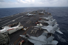 F/A-18 Super Hornets are seen on the deck of the nuclear-powered USS George Washington (CVN73) off southern coast of Vietnam in South China Sea Saturday, Oct. 20, 2012. A U.S. aircraft carrier group cruised through the disputed South China Sea on Saturday in a show of American power in waters that are fast becoming a focal point of Washington's strategic rivalry with Beijing. (AP Photo/Na Son Nguyen)