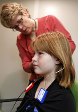 Al Hartmann  |  The Salt Lake Tribune Eve Yancery has her hearing checked by audiologist Nancy Hohler at Primary Children's Outpatient Services at Riverton Hospital Friday Ocotber 5. Loss of hearing is just one of the side-effects of her rare autoimmune disease, Cryopyrin-associated periodic syndrome (CAPS). Left untreated, the disease can cause chronic meningitis, or swelling in the brain. There's no cure, but with drugs the disease can be managed. They're expensive, though - about $20,000 a month - and getting the insurance company to pay for them is a constant struggle.