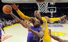 Sacramento Kings point guard Tyreke Evans (13) shoots as Los Angeles Lakers center Dwight Howard (12) defends during the first half of their preseason NBA basketball game, Sunday, Oct. 21, 2012, in Los Angeles. (AP Photo/Mark J. Terrill)