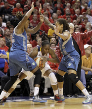 Indiana Fever guard Karima Christmas, center, gets trapped by Minnesota Lynx forward Rebekkah Brunson, left, and guard Seimone Augustus in the first half of Game Four of the WNBA basketball Finals in Indianapolis, Sunday, Oct. 21, 2012.  (AP Photo/Michael Conroy)