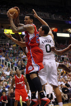 Ashley Detrick  |  The Salt Lake Tribune Matt Barnes of the Clippers takes down a rebound from the Jazz's Enes Kanter in the second half of the game against the Clippers on Saturday, Oct. 20, 2012 at Energy Solutions in Salt Lake City. The Jazz beat the Clippers, 99-91.