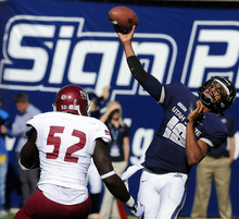 Utah State quarterback Chuckie Keeton (16) throws a pass as New Mexico State defensive lineman Donte Savage (52) defends during an NCAA college football game on Saturday, Oct. 20, 2012, in Logan, Utah. (AP Photo/The Herald Journal, Eli Lucero)