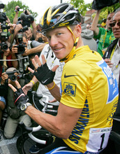 FILE - This is a July 24, 2005, file photo showing overall leader Lance Armstrong, of Austin, Texas, surrounded by press photographers, signaling seven,  for his seventh straight win in the Tour de France cycling race, prior to the start of the 21st and final stage of the race,  between Corbeil-Essonnes, south of Paris, and the French capital. UCI, the cycling governing body, agreed Monday, Oct. 22, 2012 to strip Lance Armstrong of his seven Tour de France titles.    (AP Photo/Peter Dejong, File)
