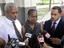 Robert Champion, Sr, left, Pam Champion, center, and attorney Chris Chestnut, speak with members of the media at the Orange County Courthouse after a sentencing hearing for Brian Jones, Monday, Oct. 22, 2012, in Orlando, Fla. Jones was the first of a dozen defendants to be sentenced in last year's hazing death of Florida A&M drum major Robert Champion, Jr. (AP Photo/John Raoux)