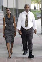Pam Champion, left, and Robert Champion, Sr. leave the Orange County Courthouse after a sentencing hearing for Brian Jones, Monday, Oct. 22, 2012, in Orlando, Fla. Jones was the first of a dozen defendants to be sentenced in last year's hazing death of Florida A&M drum major Robert Champion, Jr. (AP Photo/John Raoux)