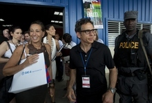 American fashion designer Donna Karan and U.S. actor and comedian Ben Stiller, center, exit the building where the opening ceremony of the Caracol Industrial Park was held, in Caracol, Haiti, Monday, Oct. 22, 2012.  The Haitian government is hosting Bill and HillaryClinton, a delegation of foreign investors and a crowd of celebrities including Karan, Stiller, and Sean Penn, Monday, to showcase the marquee project of the U.S. aid effort since the 2010 earthquake. The Clintons and their allies hope the $300 million facility will transform the northern part of this impoverished country by providing thousands of desperately needed jobs. (AP Photo/Dieu Nalio Chery)